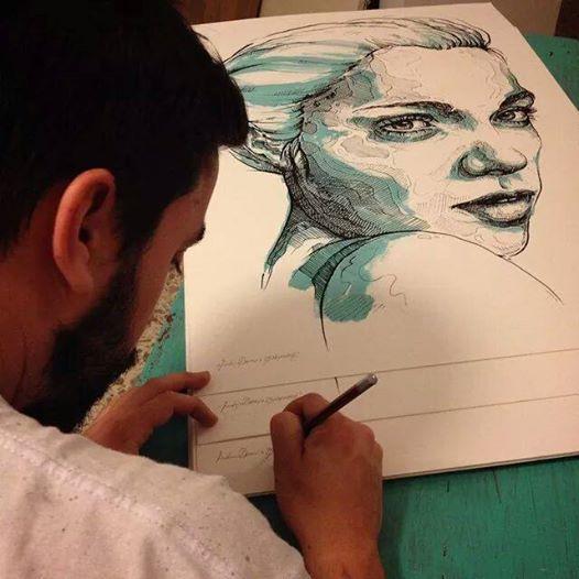 Frederico Draw firma una sua serigrafia